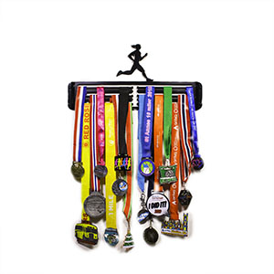 Some of Hang Your Gong's Race Medals on display on a Hang Your Gong Running Medal Hanger